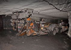 What you see here is a man operating a roof bolter underground at ICG's mine in Philippi, West Virginia. Description from bokertov.typepad.com. I searched for this on bing.com/images