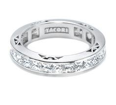 This bold, stunning band features channel-set princess cut diamonds and diamonds in crescent details <3  280845ET