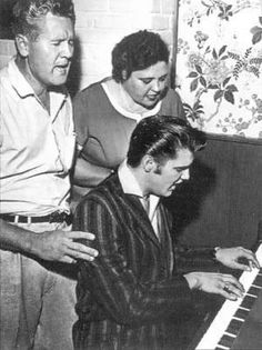 June 1956 - #Elvis and his parents singing gospel - photo by Lloyd Shearer