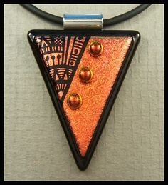 This dichroic glass triangular shaped pendant is a beautiful soft copper satin glass that I have hand engraved.