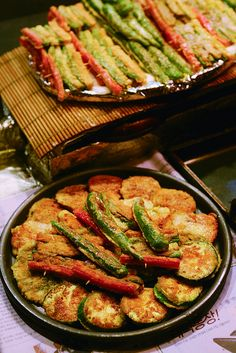 "Vegetable Jeon - In this picture, there are numerous vegetables that have been coated in flour and egg and pan fried to perfection. ""Jeon"" refers to anything that is pan-fried."