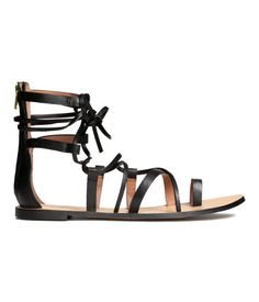 Black. PREMIUM QUALITY. Leather sandals with concealed zip at back. Leather insoles and rubber soles.
