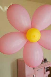 Use white balloons for petals and gold for the middle!