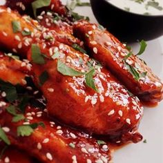 Chicken wings are egged and fried in butter, then baked in a tangy sauce of soy sauce, water, sugar, vinegar, garlic powder and salt.  Delicious, sticky chicken wings!