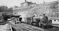 58 Thompson rebuild No. 63890 emerges from Mansfield Road tunnel with a train for Woodford. Victoria North signal box with it's unique overhanging roof is shown in this view. Date: 1955 Nottingham Station, Nottingham City, Steam Railway, Train Art, British Rail, Great Western, Water Tower, History Photos, Steam Engine