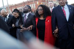 Oprah Winfrey locks arms with David Oyelowo, left, who portrays Martin Luther King Jr. in the movie ... - AP Photo/Brynn Anderson