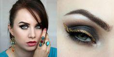 Black eyeshadow, smokey eye, gold eyeliner. Makeup look