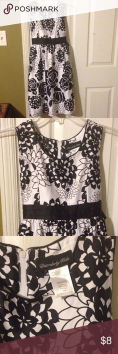 Elegant black and white sleeveless dressy dress size 14 Remember when little girls dressed like little girls? This dress will have your little girl looking adorable and age-appropriate. Black-and-white 100% polyester made by Disorderly Kids . would look really cute with a pair of red ballet flats or accented with a pretty red hair bow. Lined with a slip to produce a flared effect. Size 14 EUC. Dresses