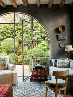 Love that arched doorway/window.  It's like a bright modern hobbit hole :)
