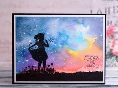 handmade card using Spectrum Aqua from Crafter's Companion Portfolio ... gorgeous sunset sky in watercolors with white masking splatters that could be fireflies ... silhouette image of a young girl ... luv the sky!