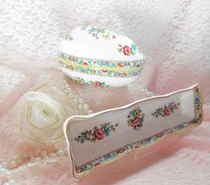This listing is for two vintage Coalport Bone china pieces each priced separately at $45.00 each.  Both pieces are perfect and in excellent vintage condition no cracks, chips or crazing of any kind.    The egg is a super piece it is large enough to be a real centerpiece with the lid on the side or slanted into the bottom with pearls or jewels inside. The pattern on both pieces is Ming Rose and they were made in england. Patterns on both pieces are A lovely rose and other assorted English…