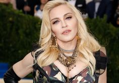 Madonna Uploaded a Super-Relatable Instagram of Herself Posing Topless with a Louis Vuitton Handbag | W Magazine