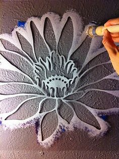 Stenciling.    Oh my goodness, now I want to stencil a big lotus on my bedrm wall!