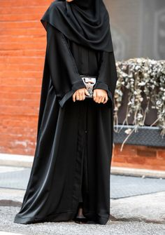 Most requested abaya Classy plain black abaya Straight cut front open Nida material Rate 2500 Niqab Fashion, Street Hijab Fashion, Muslim Fashion, Fashion Outfits, Black Hijab, Black Abaya, Abaya Designs Dubai, Burqa Designs, Hijab Style Tutorial
