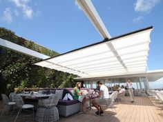 Juvia Restaurant Miami Beach: retractable awning.  The En-Fold is installed with SEFAR Architecture TENARA fabric, a fluoropolymer-coated fabric woven from ePTFE (expanded polytetraflouroethelene).