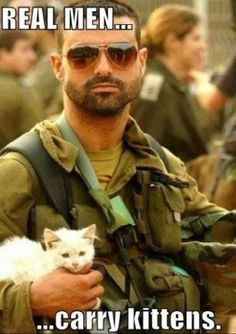 Real men carry kittens. Is it just me, or does a guy become ten times hotter if he loves cats?