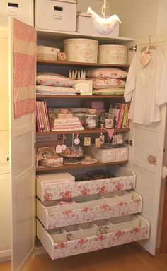 ~ Country Cottage ~  A cupboard in a sweet pink sewing room.  Looks like Ikea, drawers covered in pretty paper ~