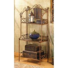 This baker's rack features rustic wood finish and metal shelves, with fabric-lined wire baskets and a sturdy scrolled design. Description from ebay.com. I searched for this on bing.com/images