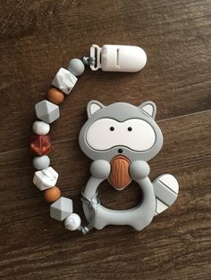 Raccoon teether and clip- fall - teething baby - teething remedies - silicone teether- custom pacifier clip- paci holder- binky clip- pacifier holder - chewelry - baby fashion - baby - baby shower gift idea - new mom - baby must haves - growinginstyle Teething Beads, Teething Toys, Baby Must Haves, Pacifier Holder, Baby Holder, Pacifier Clips, Baby Teething Remedies, Baby Teethers, Baby Sensory