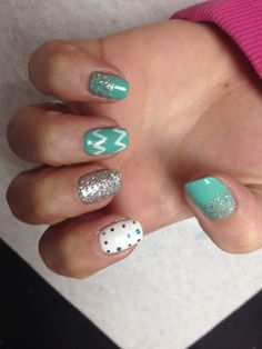 Teal with glitter fade chevron design and silver glitter accent nail and white glitter poke a dot design on accent nail  Oasis Salon and Spa Mill Hall Pa (570)726-6565