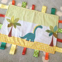 the penguin shack handmade dinosaur taggie blanket - lylia rose lifestyle blog