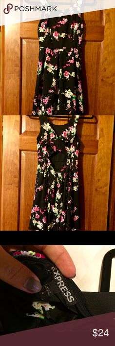 Express black floral dress Express black floral dress. Excellent condition! Cut out back. Size 4. Stretchy and very flattering. Looks great with a pair of black tights or by itself. Express Dresses