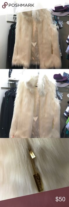 NWOT Calvin Klein fur vest have bought this beautiful white fur vest and never got to wear it because it's big on me 💔 very too classy to be sitting in my closet 🌹 i would say it fits small to medium sizes. it has two pockets with Calvin Klein zippers Calvin Klein Jackets & Coats Vests