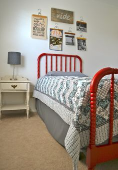 real life, one day at a time...: our little guy's room. Love this....tires as picture holders