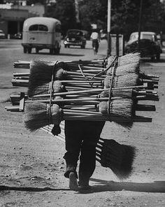 A broom Peddler going door to door, Guatemala, circa 1953