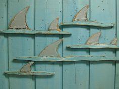 School of Sharks Fins Wooden Wall Art Sign Beach House Decor. $49.00, via Etsy.