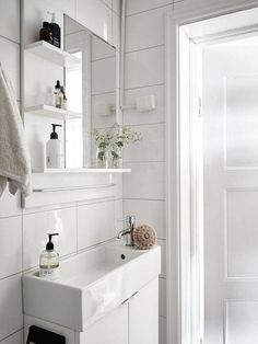 Narrow sink for a small fresh white bathroom in a swedish space.