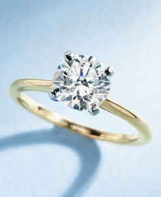 Elegant in simplicity, this Blue Nile petite solitaire engagement ring is crafted in polished 18k yellow gold to create a classic frame for your center diamond.
