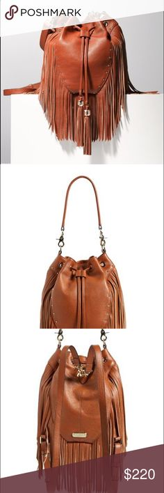 """•Dolce Vita Amber Leather Backpack• A lush cascade of fringe defines a pebbled-leather backpack for a smart fusion of contemporary design and functionality. Wear traditionally by the shoulder straps or use the removable top handle for a chic carrying option. Adjustable drawstring closure. Removable top handle; adjustable shoulder straps. Interior zip, wall and smartphone pockets. Lined. Leather. By Dolce Vita; imported. 10"""" strap drop. Comes with dust bag. If you require additional pictures…"""