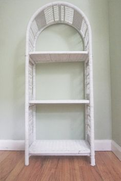 I have one of these and love it. I bought it new in the early 60s. Vintage white wicker wall bookshelf / shelf by DauphinTimeCapsule