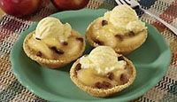 Apple Pie Tarts A La Mode: Serve these individual, apple-and-raisin-filled tarts slightly warm with a scoop of vanilla ice cream.