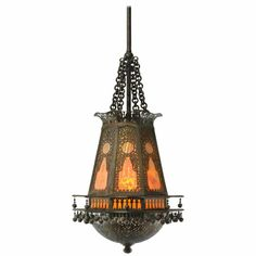 A beautiful Moorish style lantern chandelier by Tiffany Studio. This is eight sided with bronze pierced overlay and stained glass panels. The domed bottom has great open work detailing and opens to a one socket light.