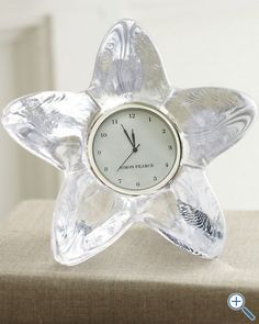 Simon Pearce Glass Starfish Clock Star light, star bright Handcrafted of molten glass and shaped into a star silhouette that houses a classic clock face, this pretty accent glimmers as it catches the light.