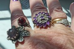 Amethyst ring - middle finger; amethyst & garnet ring - forefinger; gold wedding ring and diamond engagement ring belonged to my grandmother.