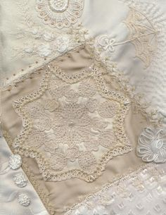 """One of the most popular pins on my """"Lace Quilt"""" board. Quilts made of lace   anlabyhouse: PARASOLS Block 12 Cream on Cream Crazy Quilt Finished."""