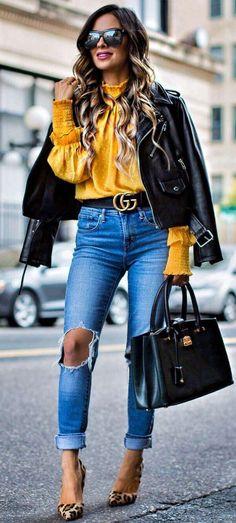 Black Jacket + Mustard Blouse + Denim                                                                             Source