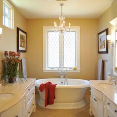 """This is a Marvin window with a custom made leaded glass insert. We used a """"seedy"""" type glass that obscured the view so we wouldn't need a window treatment."""