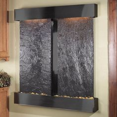 Elegant Indoor Water Fall Offer Wall Mounted Installment With Black Marble Materials And Recessed LED Lighting Along With Rock Detail Ideas. Creating a wall indoor water fall that measures almost three feet across. This design is a truly unique. engaging and an elegant addition to any indoor space. Includes long-lasting super bright white LED lights rated for over 10,000 hours.