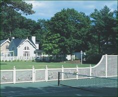 Formal Tennis Court - Let the games begin. This Lattice Court enclosure has curving rails, Urn Post Tops, and our customer's stain preference. Picket Fence Panels, Fence Gate, Walpole Woodworkers, Walpole Outdoors, Tennis Photography, Wooden Playset, Types Of Fences, Fence Design, Landscape Architecture