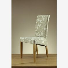 Patterned Beige Fabric Dining Chair with Scroll Back Design and Solid Oak Legs. The high back design with scroll detailing provides comfort and support Fabric Dining Chairs, Chair Fabric, Dining Room Furniture, Solid Wood Furniture, Solid Oak, Accent Chairs, New Homes, Living Room, Modern