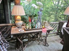 """Reflections""- bar on open porch with big fireplace!"