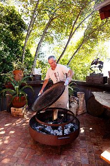 Terrace with a fire pit and paella pan. My idea of an outdoor kitchen.