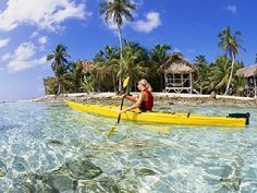 Sea kayaking off Long Caye stay in a vacation home in Belize