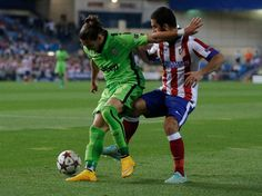 Juventus' Martin Caceres, left, and Atletico's Arda Turan vie for the ball during the Group A Champions League soccer match between Atletico De Madrid and Juventus at the Vicente Calderon stadium in Madrid, Spain, Wednesday, Oct. 1, 2014. Photo: Daniel Ochoa De Olza, AP / AP