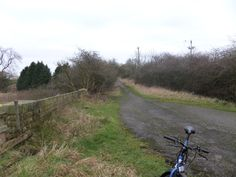 Showing the rise of the original road with road markers still visible, Shildon is around one third of a mile distant