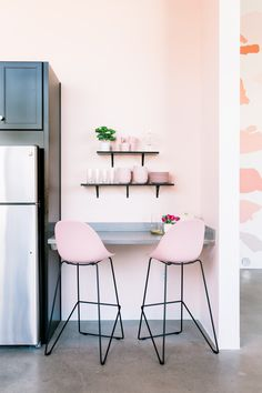 The kitchen of Create & Cultivate Clubhouse in Los Angeles Pink Kitchen Walls, Kitchen Paint, Pink Kitchen Decor, Kitchen Design, Light Pink Walls, Exposed Ceilings, Black Kitchens, Pink Kitchens, Kitchen Black